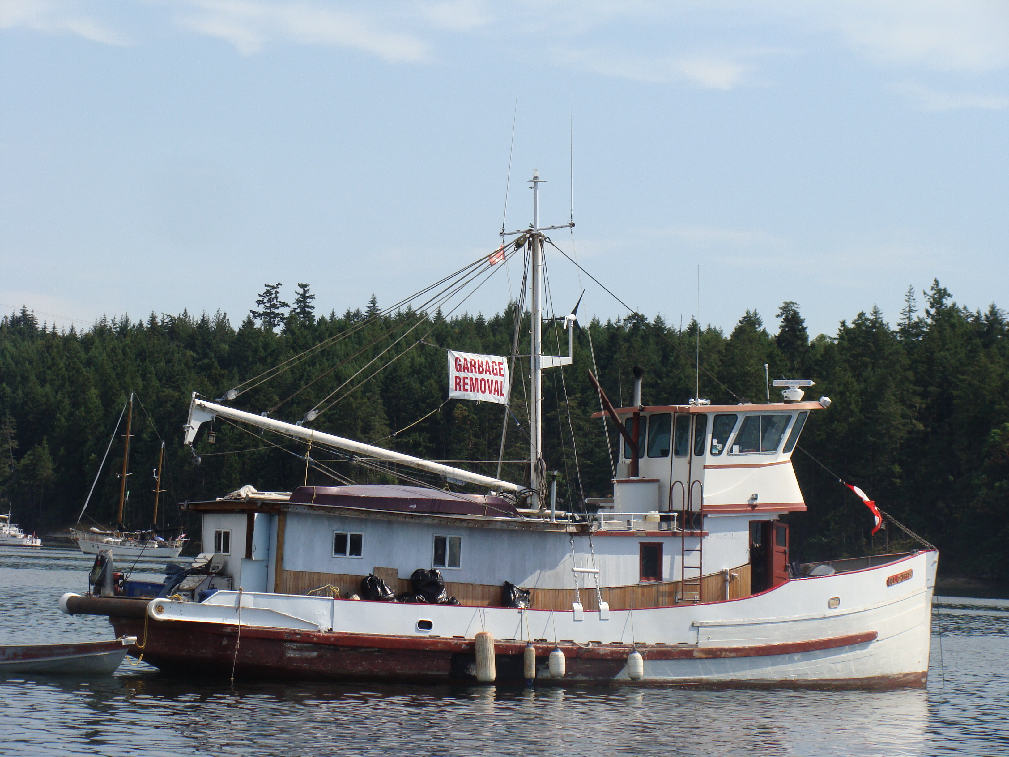 Old commercial fishing boat reportedly sinks in maple bay for Old fishing boat